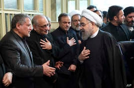 Iranian President Hassan Rouhani, right, greets Mohsen Hashemi, left, son of former President Akbar Hashemi Rafsanjani, who died on Sunday after suffering a heart attack, in a mourning ceremony at the Jamaran mosque in northern Tehran, Jan. 9, 2017.