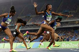Brianna Rollins from the United States celebrates after winning the gold medal in the women's 100-meter hurdles final during the athletics competitions of the 2016 Summer Olympics at the Olympic stadium in Rio de Janeiro, Brazil, Wednesday, Aug. 17,