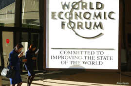 An attendee arrives in the Congress Hall during the World Economic Forum annual meeting in Davos, Switzerland Jan. 20, 2017.