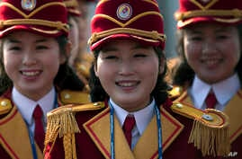 Members of the North Korea cheering group gather before a welcome ceremony inside the Gangneung Olympic Village prior to the 2018 Winter Olympics in Gangneung, South Korea, Feb. 8, 2018.