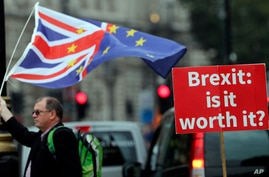 An anti-Brexit poster is seen in front of the Houses of Parliament in London, Sept. 4, 2018. Secretary of State for Exiting the European Union Dominic Raab will make a statement to the House on his recent meeting with EU Chief Brexit Negotiator Miche...