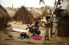 Central African Republic Tensions: FILE - Families living in a refugee camp prepare food in Kaga-Bandoro, Central African Republic, Tuesday Feb. 16,  2016.