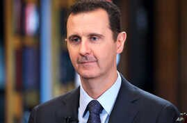 Syrian President Bashar Assad speaks during an interview with Venezuela's state-run Telesur network, in Damascus, Syria, 25 Sept. 2015.