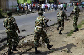 Soldiers from a special unit disperse a group of protesters by firing in the air in the Musage neighborhood of Bujumbura, Burundi, May 18, 2015.