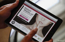 Ashley Madison founder Noel Biderman demonstrates his website on a tablet computer during an interview in Hong Kong August 28, 2013. Founded in 2002, Ashley Madison, the world's biggest online dating website for married men and women, has over 20 mil