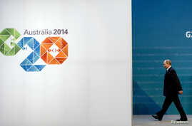 Russia's President Vladimir Putin arrives for the G20 summit in Brisbane November 15, 2014. The meeting of leaders of the Group of 20 economies has opened in Brisbane, Australia, with Australia's Prime Minister Tony Abbott stressing the importance of