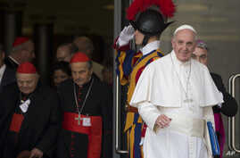 Pope Francis leaves a morning session of the Synod of bishops, at the Vatican, Oct. 5, 2015. He urged the contentious gathering of the world's bishops on family issues to put aside personal prejudices and have the courage and humility to be guided by...
