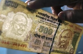 Weakening Currency Adds to India's Economic Woes