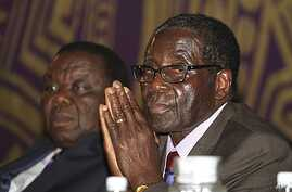 Zimbabwean Prime Minister Morgan Tsvangirai, left, and President Robert Mugabe, Harare, November 11, 2011.