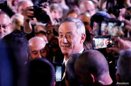 FILE - Benny Gantz, a former Israeli armed forces chief and head of the Israel Resilience party, arrives to deliver his first political speech at the party campaign launch in Tel Aviv, Israel, Jan. 29, 2019.