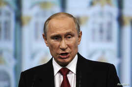 Russia's President Vladimir Putin delivers a speech during a session of the St. Petersburg International Economic Forum 2014, May 23, 2014.