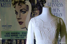 "FILE - A mannequin is seen with a dress worn by Grace Kelly in the film ""The Swan"" in an exhibition of the late star's wardrobe at the Victoria and Albert Museum in London, April 15, 2010."