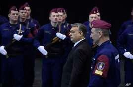 """Hungarian Prime Minister Viktor Orban, 2nd right, arrives for a swearing-in ceremony for a new group of border guards known locally as """"border hunters,"""" in Budapest, Hungary, March 7, 2017."""