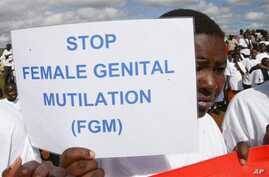Masai girl holds protest sign during anti-Female Genital Mutilation (FGM) run in Kilgoris, Kenya
