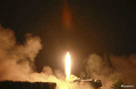 A tactical rocket firing drill carried out by units of the Korean People's Army (KPA) Strategic Force is seen during a visit by North Korean leader Kim Jong Un in the western sector of the front in this undated photo released by North Korea's Korean