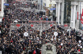 Journalists and their supporters march during a protest against the arrests of journalists in Istanbul, March 4, 2011.