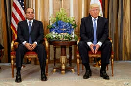 FILE - In this May 21, 2017 file photo, U.S. President Donald Trump, right, holds a bilateral meeting with Egyptian President Abdel Fattah al-Sisi in Riyadh.