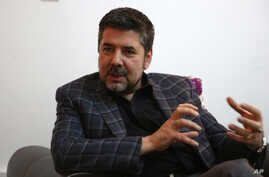 In this Thursday, May 26, 2016, photo, Rahmatullah Nabil, a former head of Afghanistan's secret service speaks during an interview with the Associated press in Kabul, Afghanistan.
