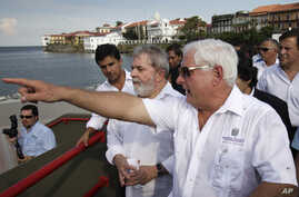 FILE - Panama's President Ricardo Martinelli (left) shows Brazil's former President Luiz Inacio Lula da Silva (second from right) an extension of the coastal strip build by Brazilian company Norberto Odebrecht in Panama City, May 20, 2011.