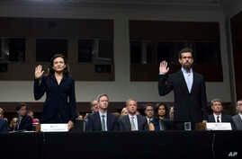 Facebook COO Sheryl Sandberg, left, accompanied by Twitter CEO Jack Dorsey are sworn in before the Senate Intelligence Committee hearing on Capitol Hill, Sept. 5, 2018, in Washington.