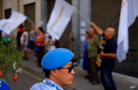 A U.N peacekeeper stands guard during a protest calling to the rival leaders of the two communities for peace in the Cyprus island, at Ledras main crossing point inside the U.N buffer zone that divided the Greek and Turkish Cypriots controlled areas,