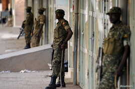 FILE - Ugandan soldiers stand along a street in Kampala, Uganda, Feb. 20, 2016. Ugandan President Yoweri Museveni extended his 30-year rule earlier this year by winning an election critics say lacked transparency and his main opponent Kizza Besiyge d