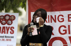 FILE - A member of the protest group wipes away tears during a daily sit-in of the #BringBackOurGirls protest marking the eve of the first anniversary of the killing of 59 students of the Bunu Yadi Federal Government College in Yobe State by Boko Har
