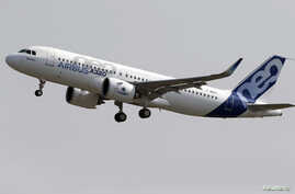 FILE - Normal rate of ascent for commercial jets like the Airbus A320 is 300 to 600 meters per minute, an Indonesian official says; AirAsia Flight QZ8501, which crashed Dec. 28, was climbing at about 1,800 meters per minute.