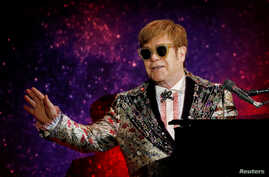 "Singer Elton John performs before announcing his final ""Farewell Yellow Brick Road"" tour in Manhattan, New York, U.S., Jan. 24, 2018."