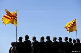 FILE - The flag of former South Vietnam is seen as visiting officals of the Vietnamese community attend a ceremony on the flight deck of the USS Midway.