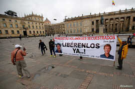 "People protest against the kidnapping of Dutch journalists Derk Johannes Bolt and Eugenio Ernest Marie in Bogota, Colombia, June 21, 2017. The banner reads: ""Dutch journalists kidnapped, Liberty Now."" Bolt and Marie were released by ELN rebels, June"