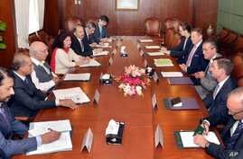 In this photo released by the Press Information Department, Pakistan's adviser on foreign affairs, Sartaj Aziz, third from left, talks with Richard Olson, third from right, the U.S. special representative for Afghanistan and Pakistan, in Islamabad, J