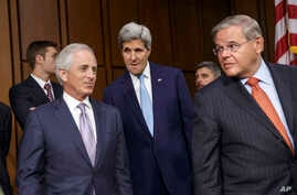 Secretary of State John Kerry, center, is flanked by Senate Foreign Relations Chairman Robert Menendez, D-N.J., right, and Sen. Bob Corker, R-Tenn., the ranking member, left, as he arrives to shore up President Barack Obama's strategy to combat Islam...