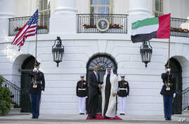 FILE - President Barack Obama, left, shakes hands with Sheikh Mohamed bin Zayed Al Nahyan, Crown Prince of Abu Dhabi, Deputy Supreme Commander of the UAE Armed Forces and Chairman of the Executive Council of the Emirate of Abu Dhabi, as he arrives at