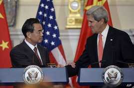Secretary of State John Kerry, right, and Chinese Foreign Minster Wang Yi, left, shake hands after making statements before their bilateral meeting at the State Department in Washington, Thursday, Sept. 19, 2013. Syria and North Korea as well as othe