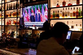 A television screen at the Baro bar broadcasts the Singapore summit meeting between  U.S. President Donald Trump and North Korean leader Kim Jong Un, as customers sit at the bar in the Korea Town section of Manhattan, New York, U.S., June 11, 2018.