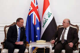 A handout picture released by Iraq's Prime Minister's office shows  Iraqi Prime Minister Haider al-Abadi (R) and his Australian counterpart Tony Abbott meeting in Baghdad, Jan. 4, 2015.
