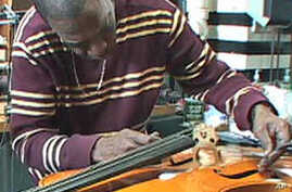 Charles West (pictured) and Larry Jernigan estimate they've fixed 450 instruments and tuned about 125 pianos so far this year.