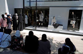Tourists wait to enter a Chanel store in Istanbul, Turkey, Aug. 13, 2018.