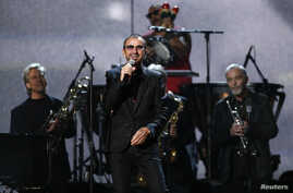 """Ringo Starr performs """"Photograph"""" at the 56th annual Grammy Awards in Los Angeles, Jan. 26, 2014."""
