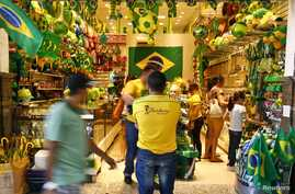 People pass a souvenir shop in the city of Fortaleza, June 9, 2014.