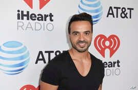 Luis Fonsi attends the iHeartRadio Summer Pool Party at the Fontainebleau Miami Beach, June 9, 2017, in Miami Beach, Fla.