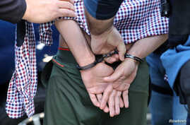 U.S. Immigration and Customs Enforcement officers make an arrest in San Clemente, Calif., May 11, 2017.