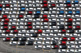FILE - New Ford vehicles are seen at a parking lot of the Ford factory in Sao Bernardo do Campo, Brazil, Feb. 12, 2015.