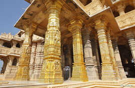 FILE - A security guard stands amid the gold-plated pillars of the Hindu god Shiva temple at Somnath in the western Indian state of Gujarat, Feb. 1, 2014.