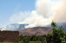 Smoke is seen billowing from the Mount Chaambi area during air strikes launched by Tunisian forces against Islamist militants near the Algerian border, August 2, 2013.