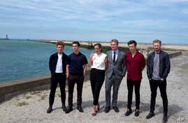"""Left to right, Tom Glynn-Carney, Fionn Whitehead, Emma Thomas, director Christopher Nolan, Harry Styles and Jack Lowden pose for photographers upon arrival at the premiere of the movie """"Dunkirk,"""" in Dunkirk, northern France, July 16, 2017. The film,"""