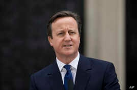 British Prime Minister David Cameron at 10 Downing Street in London, as he makes a speech after arriving back from visiting Britain's Queen Elizabeth II, March 30, 2015.