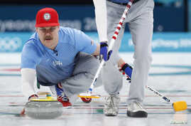 Second Matt Hamilton of the U.S. delivers the stone, Feb. 24, 2018, in the men's curling final against Sweden in Gangneung, South Korea.
