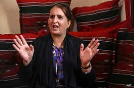 "Taghreed Abu Teer, recalls being held by Hamas authorities for 11 days and interrogated under ""humiliating circumstances"" for her activities with the rival Fatah movement during an interview with The Associated Press at a relative's home in Khan Youn"